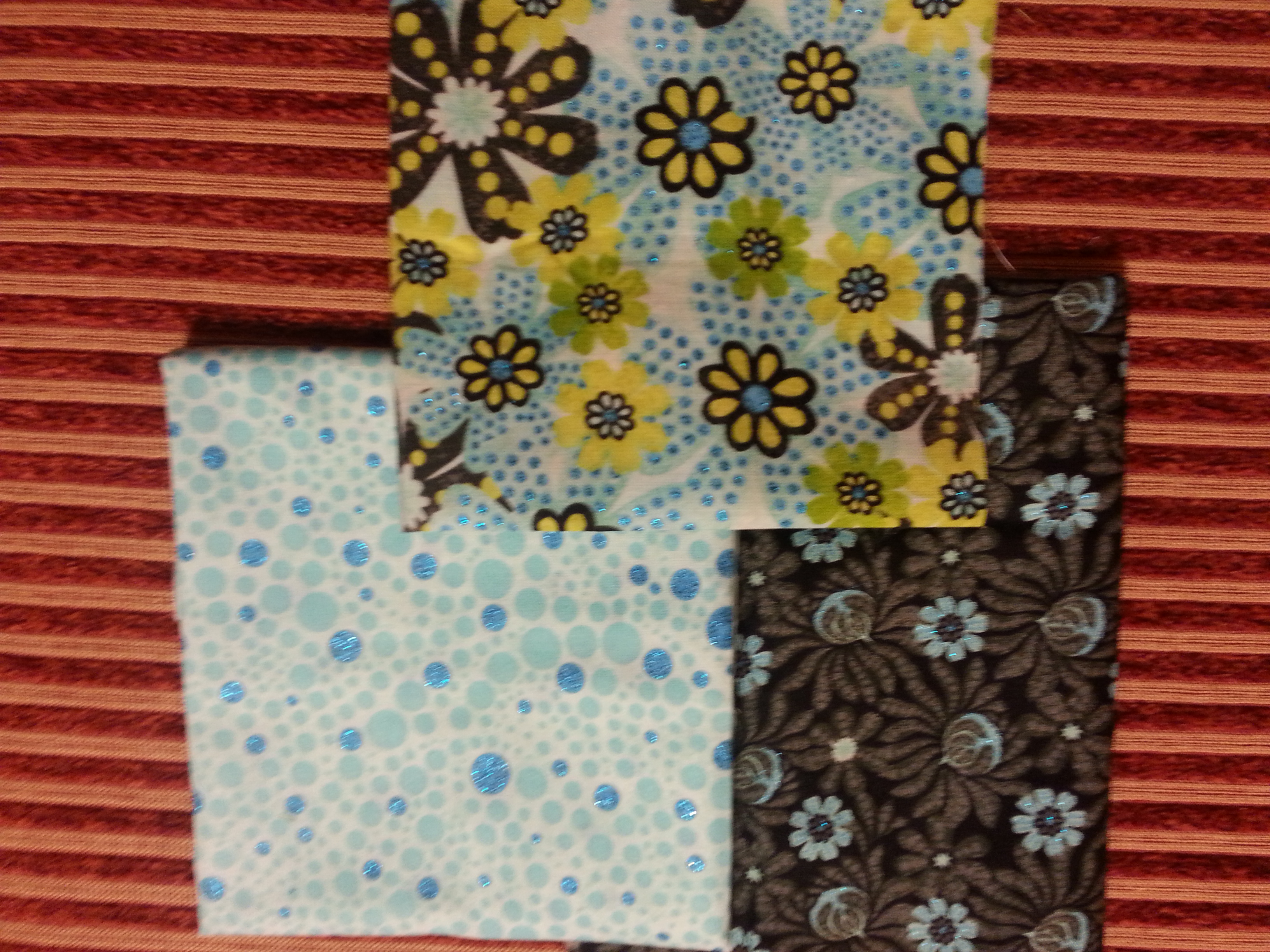 Here are the fat quarters I chose...they all have a slight shimmer on the flowers.